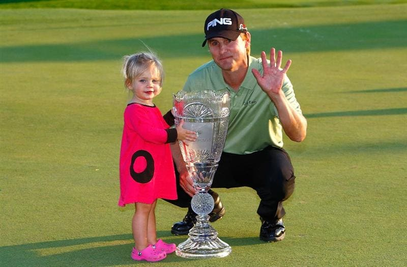 JERSEY CITY, NJ - AUGUST 30:  Heath Slocum and his daughter Stella pose with the championship trophy after Heath won The Barclays on August 30, 2009 at Liberty National in Jersey City, New Jersey.  (Photo by Kevin C. Cox/Getty Images)