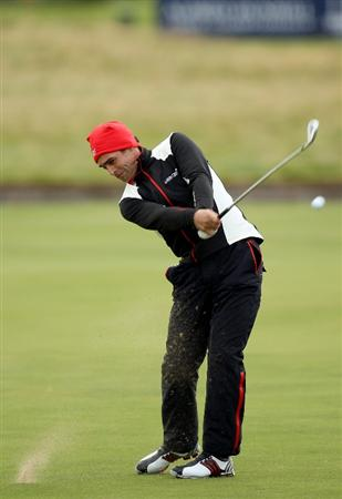 CARNOUSTIE, SCOTLAND - OCTOBER 01:  Lee Slattery of England plays his second shot to the 18th green during the first round of The Alfred Dunhill Links Championship at Carnoustie Golf Club on October 1, 2009 in Carnoustie, Scotland.  (Photo by Ross Kinnaird/Getty Images)