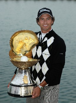 DOHA, QATAR - JANUARY 27:  Adam Scott of Australia with the winners trophy after the final round of the Commercialbank Qatar Masters held at the Doha Golf Club on January 27, 2008 in Doha,Qatar.  (Photo by Ross Kinnaird/Getty Images)