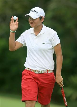 SINGAPORE - MARCH 05:  Yani Tseng of Chinese Taipei walks off the fifth green during the first round of the HSBC Women's Champions at the Tanah Merah Country Club on March 5, 2009 in Singapore.  (Photo by Scott Halleran/Getty Images)