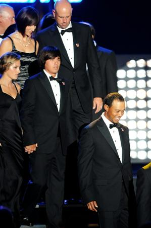 CARDIFF, WALES - SEPTEMBER 29:  Tiger Woods and members of the United States Ryder Cup team onstage with their wives and partners during Welcome To Wales at Millennium Stadium on September 29, 2010 in Cardiff, Wales.  (Photo by Eamonn McCormack/Getty Images)