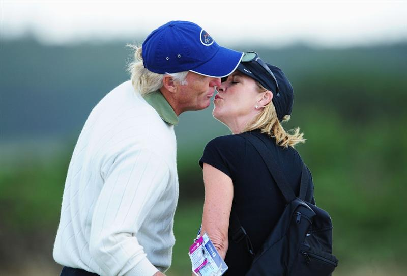 TURNBERRY, SCOTLAND - JULY 14:  Greg Norman of Australia kisses Chris Evert during a practice round prior to the 138th Open Championship on the Ailsa Course, Turnberry Golf Club on July 14, 2009 in Turnberry, Scotland. (Photo by Stuart Franklin/Getty Images)