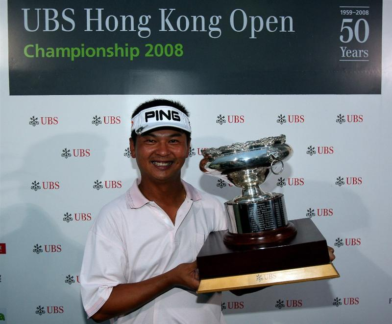 HONG KONG, CHINA - NOVEMBER 23:   Lin Wen-Tang of Chinese Taipei with the trophy for winning the playoff during the final round of the UBS Hong Kong Open at the Hong Kong Golf Club on November 23, 2008 in Fanling, Hong Kong.  (Photo by Stuart Franklin/Getty Images)