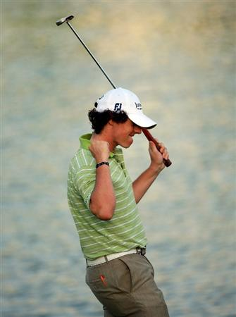 DUBAI, UNITED ARAB EMIRATES - FEBRUARY 01:  Rory McIlroy of Northern Ireland celebrates on the 18th green after winning the Dubai Desert Classic on the Majilis course at Emirates Golf Club on February 1, 2009 in Dubai, United Arab Emirates.  (Photo by Andrew Redington/Getty Images)