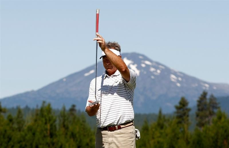 SUNRIVER, OR - AUGUST 21:  John Cook lines up a putt on the 7th hole during the second round of the Jeld-Wen Tradition on August 21, 2009 at Crosswater Club at Sunriver Resort in Sunriver, Oregon.  (Photo by Jonathan Ferrey/Getty Images)