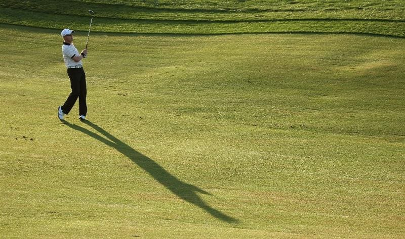 VILAMOURA, PORTUGAL - OCTOBER 16:  Simon Dyson of England plays his second shot on the tenth hole during the second round of the Portugal Masters at the Oceanico Victoria Golf Course on October 16, 2009 in Vilamoura, Portugal.  (Photo by Andrew Redington/Getty Images)