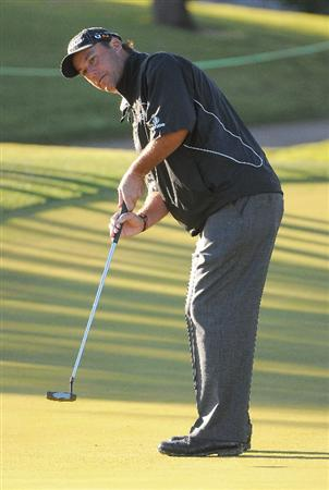 LAS VEGAS- OCTOBER 16:  Chris DiMarco putts for birdie on the 12th hole during the first round of the Justin Timberlake Shriners Hospitals for Children Open held at the TPC Summerlin on October 16, 2008 in Las Vegas, Nevada. (Photo by Marc Feldman/Getty Images)