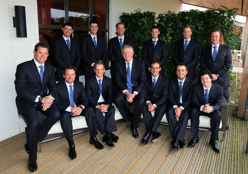 NEWPORT, WALES - SEPTEMBER 30:  (L-R) Back Row; Lee Westwood, Padraig Harrington, Ross Fisher, Peter Hanson, Martin Kaymer, Ian Poulter, Miguel Angel Jimenez; Front Row; Lee Westwood, Graeme McDowell, Luke Donald, Team Captain Colin Montgomerie, Edoardo Molinari, Francesco Molinari and Rory McIlroy pose prior to the Opening Ceremony prior to the 2010 Ryder Cup at the Celtic Manor Resort on September 30, 2010 in Newport, Wales. (Photo by David Cannon/Getty Images)