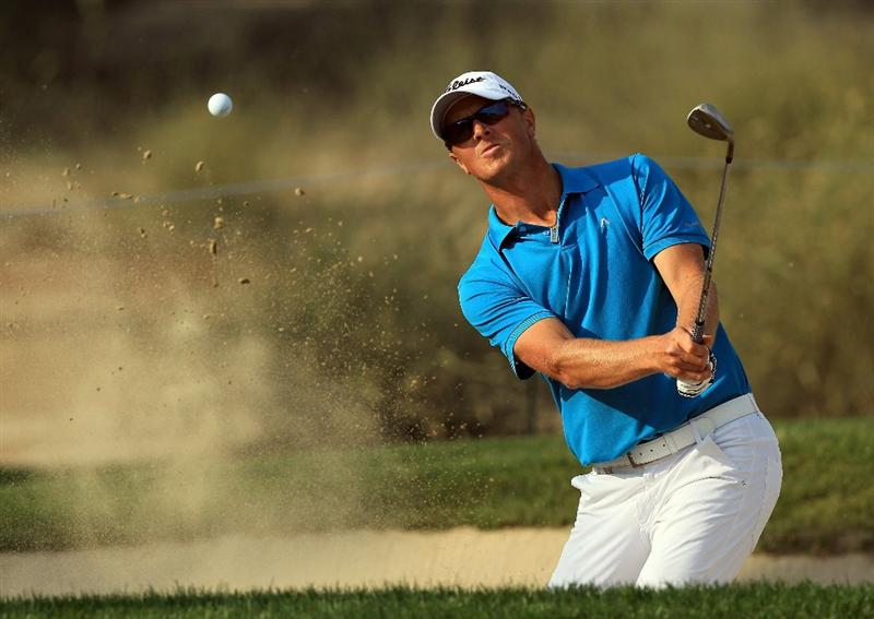 DUBAI, UNITED ARAB EMIRATES - FEBRUARY 10:  Fredrik Andersson Hed of Sweden plays his third shot to the 14th hole during the first round of the 2011 Omega Dubai Desert Classic on the Majilis Course at the Emirates Golf Club on February 10, 2011 in Dubai, United Arab Emirates.  (Photo by David Cannon/Getty Images)
