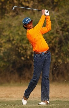 NEW DELHI, INDIA - FEBRUARY 08:  Digvijay Singh of India hits his second shot at the 15th hole during the second round of the Emaar-MGF Indian Masters at the Delhi Golf Club on February 8, 2008 in Delhi, India.  (Photo by Stuart Franklin/Getty Images)