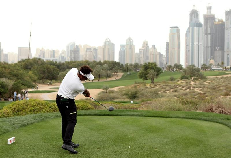 DUBAI, UNITED ARAB EMIRATES - FEBRUARY 06:  Thongchai Jaidee of Thailand tees off on the eighth hole during the third round of the Omega Dubai Desert Classic on February 6, 2010 in Dubai, United Arab Emirates.  (Photo by Andrew Redington/Getty Images)