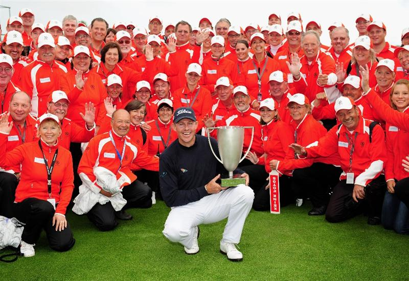 COLOGNE, GERMANY - SEPTEMBER 13:  James Kingston of South Africa with the volunteers as he holds the winners trophy after winning the playoff against Ander Hansen of Denmark during the final round of The Mercedes-Benz Championship at The Gut Larchenhof Golf Club on September 13, 2009 in Cologne, Germany.  (Photo by Stuart Franklin/Getty Images)
