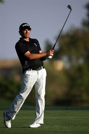 DUBAI, UNITED ARAB EMIRATES - JANUARY 30:  Gareth Maybin of Northern Ireland hits his second shot on the 18th hole during the second round of the Dubai Desert Classic on the Majilis course at Emirates Golf Club on January 30, 2009 in Dubai, United Arab Emirates.  (Photo by Andrew Redington/Getty Images)