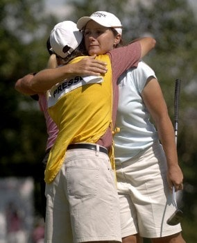 Karen Stupples receives a hug from Birdie Kim's caddie during the final round of the 2005 U.S. Women's Open at Cherry Hills Country Club in Englewood, Colorado, June 26, 2005.Photo by Steve Grayson/WireImage.com