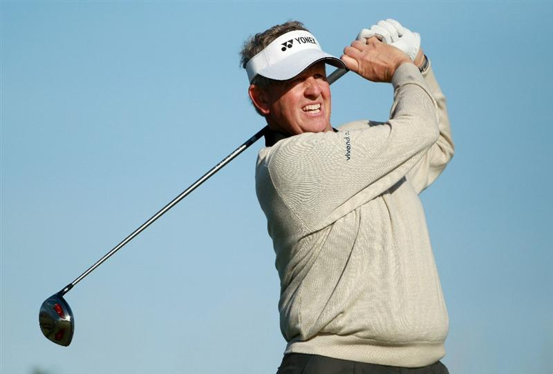 KINGSBARNS, SCOTLAND - OCTOBER 07:  Colin Montgomerie of Scotland drives off the seventh tee during the first round of The Alfred Dunhill Links Championship at Kingsbarns Golf Links on October 7, 2010 in Kingsbarns, Scotland.  (Photo by Andrew Redington/Getty Images)