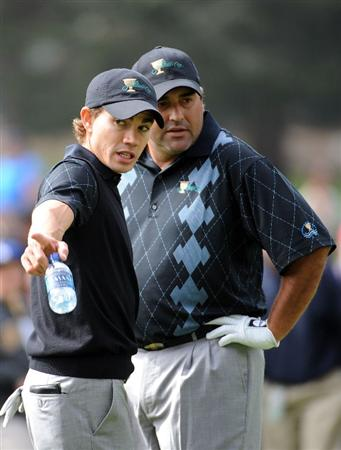 SAN FRANCISCO - OCTOBER 08:  Camilo Villegas and Angel Cabrera of the International Team discuss a shot on the fifth fairway during the Day One Foursome Matches of The Presidents Cup at Harding Park Golf Course on October 8, 2009 in San Francisco, California.  (Photo by Harry How/Getty Images)