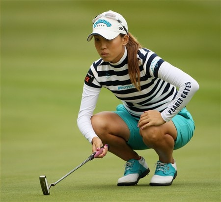 SUNNINGDALE, UNITED KINGDOM - JULY 31:  Momoko Ueda of Japan lines up an eventual eagle putt on the 10th green during the first round of the 2008 Ricoh Women's British Open held on the Old Course at Sunningdale Golf Club on July 31, 2008 in Sunningdale, England.  (Photo by Warren Little/Getty Images)