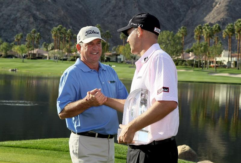 LA QUINTA, CA - JANUARY 25:  Bill Haas (R) is congratulated by his dad Jay Haas after winning the Bob Hope Classic at the Palmer Private Course at PGA West on January 25, 2010 in La Quinta, California.  (Photo by Jeff Gross/Getty Images)