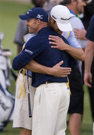 LAS VEGAS, NV - OCTOBER 24: Jonathan Byrd (R) hugs his caddie, Adam Hayes (L), after hitting a hole in one on the fourth hole of the playoff to win the Justin Timberlake Shriners Hospitals for Children Open at TPC Sunderlin on October 24, 2010 in Las Vegas, Nevada. (Photo by Steve Dykes/Getty Images)