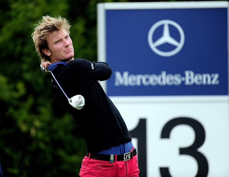 COLOGNE, GERMANY - SEPTEMBER 10:  Chris Wood of England plays his tee shot on the 13th hole during the first round of The Mercedes-Benz Championship at The Gut Larchenhof Golf Club on September 10, 2009 in Cologne, Germany.  (Photo by Stuart Franklin/Getty Images)