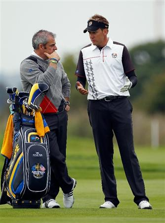 NEWPORT, WALES - SEPTEMBER 28:  Europe Vice Captain Paul McGinley (L) chats with Ian Poulter during a practice round prior to the 2010 Ryder Cup at the Celtic Manor Resort on September 28, 2010 in Newport, Wales. (Photo by Sam Greenwood/Getty Images)