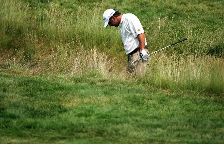 OAKMONT, PA - JUNE 17:  Harrison Frazar hits out of the rough on the eighth hole during the final round of the 107th U.S. Open Championship at Oakmont Country Club on June 17, 2007 in Oakmont, Pennsylvania.  (Photo by Donald Miralle/Getty Images)