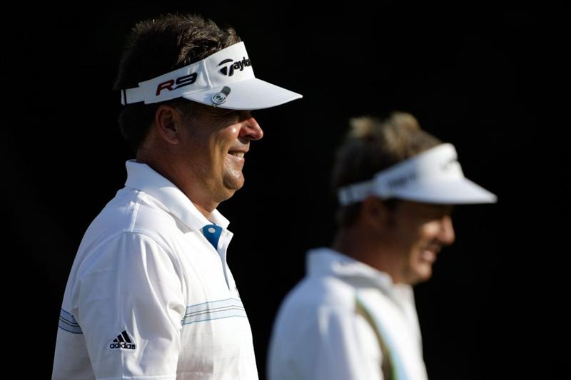 CHASKA, MN - AUGUST 13:  Kenny Perry walks down the tenth fairway with Stuart Appleby of Australia during the first round of the 91st PGA Championship at Hazeltine National Golf Club on August 13, 2009 in Chaska, Minnesota.  (Photo by Jamie Squire/Getty Images)