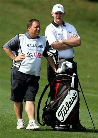 HONG KONG - NOVEMBER 18: Stephen Gallacher of Scotland and his caddie waits on the 3rd hole during previews ahead of the USB Hong Kong Open at The Hong Kong Golf Club  on November 18, 2010 in Hong Kong, Hong Kong.  (Photo by Stanley Chou/Getty Images)