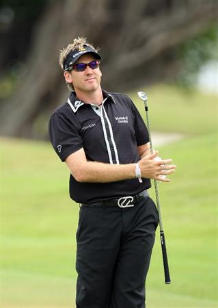 DORAL, FL - MARCH 13:  Ian Poulter of England plays his second shot at the 1st hole during the second round of the World Golf Championships-CA Championship at the Doral Golf Resort & Spa on March 13, 2009 in Miami, Florida  (Photo by David Cannon/Getty Images)