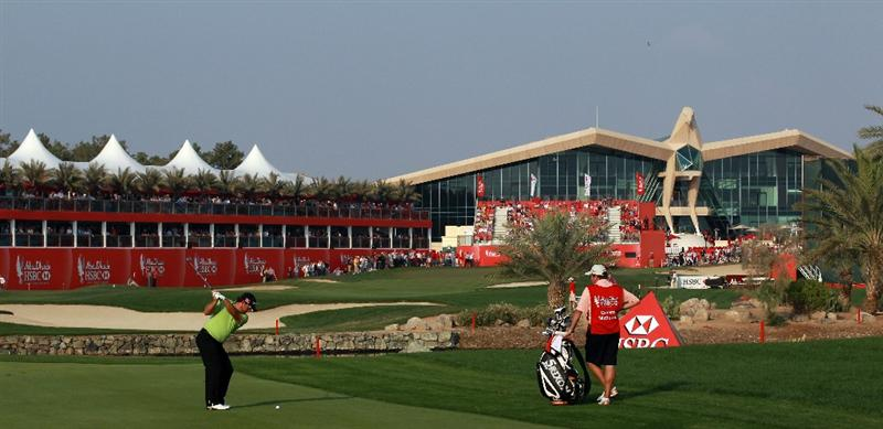 ABU DHABI, UNITED ARAB EMIRATES - JANUARY 22: Graeme McDowell of Northern Ireland plays his second shot to the 18th hole during the final round of the 2011 Abu Dhabi HSBC Golf Championship held at the Abu Dhabi Golf Club on January 23, 2011 in Abu Dhabi, United Arab Emirates.  (Photo by David Cannon/Getty Images)