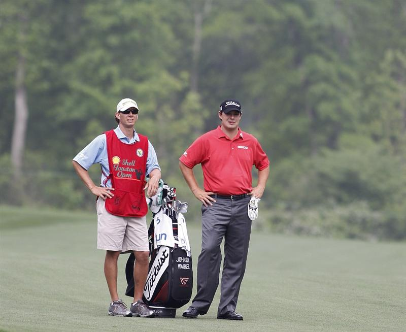 HUMBLE, TX - APRIL 01:  Johnson Wagner (R) prepares to play a shot during the second round of the Shell Houston Open at Redstone Golf Club on April 1, 2011 in Humble, Texas.  (Photo by Michael Cohen/Getty Images)