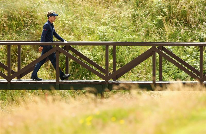 TURNBERRY, SCOTLAND - JULY 14:   Luke Donald of England crosses a bridge during a practice round prior to the 138th Open Championship on the Ailsa Course, Turnberry Golf Club on July 14, 2009 in Turnberry, Scotland.  (Photo by Richard Heathcote/Getty Images)