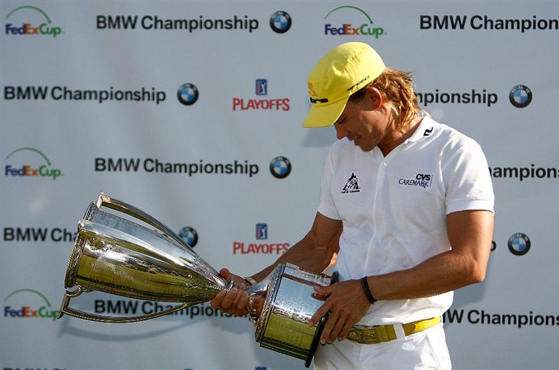 ST. LOUIS - SEPTEMBER 07:  Camilo Villegas hoists the trophy after winning the BMW Championship on September 7, 2008 at Bellerive Country Club in St. Louis, Missouri.  (Photo by Mike Ehrmann/Getty Images)