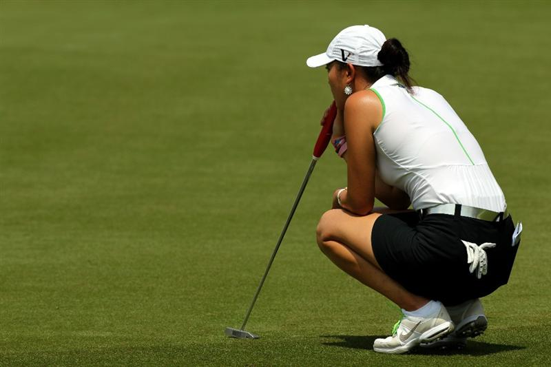 KUALA LUMPUR, MALAYSIA - OCTOBER 22: Michelle Wie of the USA lines up a putt on the 3rd hole during Round One of the Sime Darby LPGA on October 22, 2010 at the Kuala Lumpur Golf and Country Club in Kuala Lumpur, Malaysia. (Photo by Stanley Chou/Getty Images)