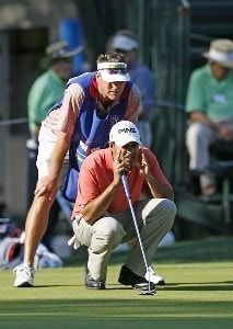 Arjun Atwal gets aid from his caddie on the 8th green during the first round of the 2006 Verizon Herizon Heritage Classic Thursday, April 13, 2006, at Harbour Town Golf Links in Hilton Head Island, South Carolina.Photo by Kevin C.  Cox/WireImage.com