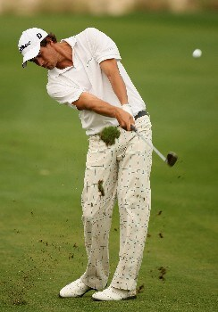 DOHA, QATAR - JANUARY 26:  Adam Scott of Australia on the par five 18th hole during the third round of the Commercialbank Qatar Masters held at the Doha Golf Club on January 26, 2008 in Doha,Qatar.  (Photo by Ross Kinnaird/Getty Images)