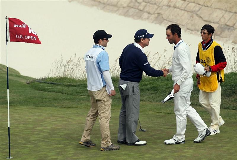 PEBBLE BEACH, CA - JUNE 20:  Tom Watson walks shakes hands with Edoardo Molinari the 18th green during the final round of the 110th U.S. Open at Pebble Beach Golf Links on June 20, 2010 in Pebble Beach, California.  (Photo by Stephen Dunn/Getty Images)