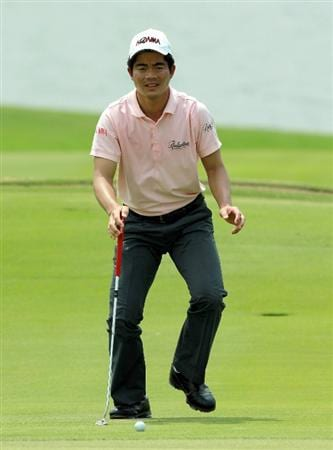CHON BURI, THAILAND - FEBRUARY 24:  Liang Wen-Chong of China reacts on the 18th hole during day one of The Open Championship Asia Final Qualifying tournament at Amata Spring Country Club on February 24, 2011 in Chon Buri, Thailand.  (Photo by Stanley Chou/Getty Images)