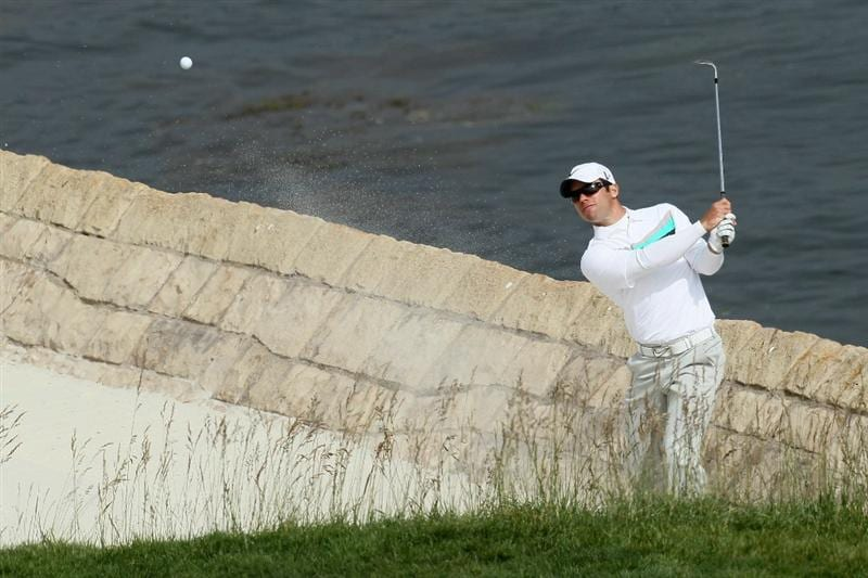 PEBBLE BEACH, CA - JUNE 20:  Paul Casey of England plays a bunker shot on the 18th hole during the final round of the 110th U.S. Open at Pebble Beach Golf Links on June 20, 2010 in Pebble Beach, California.  (Photo by Stephen Dunn/Getty Images)