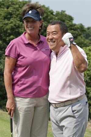 HAIKOU, CHINA - OCTOBER 29:  Solheim Cup's captain Rosie Jones (L) of the USA and Hong Kong actor Eric Tsang pose for a photograp on the 8th tee during day three of the Mission Hills Start Trophy tournament at Mission Hills Resort on October 29, 2010 in Haikou, China. The Mission Hills Star Trophy is Asia's leading leisure liflestyle event which features Hollywood celebrities and international golf stars.  (Photo by Victor Fraile/Getty Images for Mission Hills)