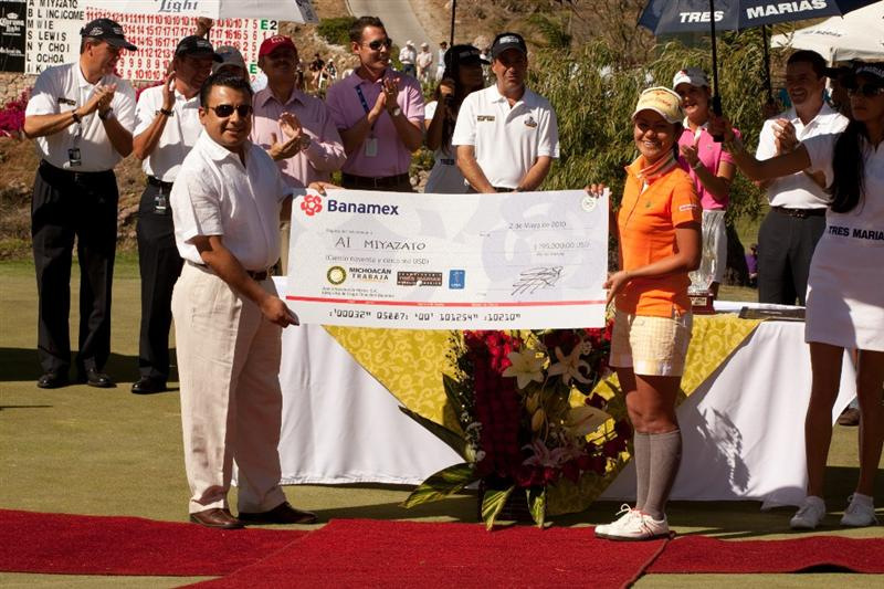 MORELIA, MEXICO - MAY 2: Ai Miyazato of Japan is presented with the winner's check by Fidel Calderon Torreblanco of the Mexican government following the fourth round of the Tres Marias Championship at the Tres Marias Country Club on May 2, 2010 in Morelia, Mexico. (Photo by Darren Carroll/Getty Images)