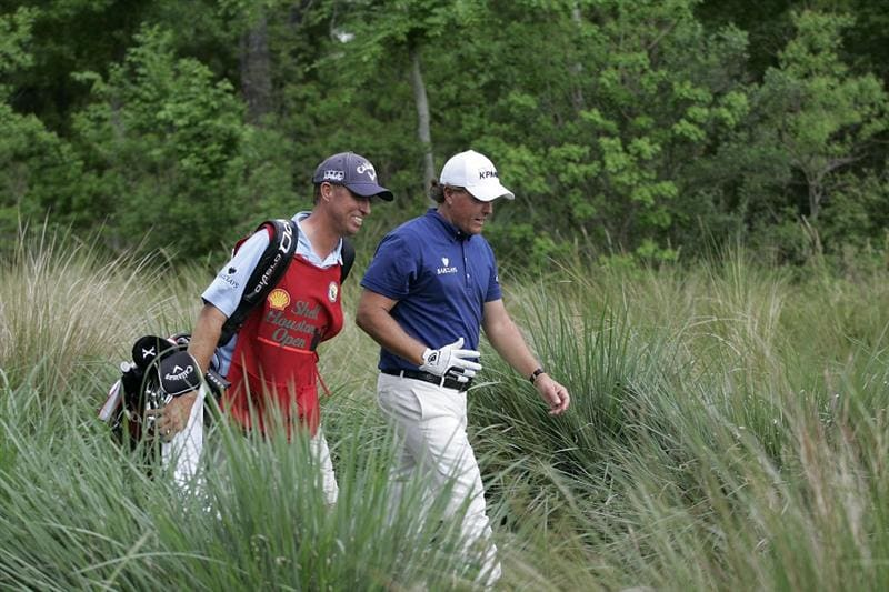 HUMBLE, TX - APRIL 03: Phil Mickelson and his caddie James Mackay walk to the 15th fairway during the final round of the Shell Houston Open at Redstone Golf Club on April 3, 2011 in Humble, Texas.  (Photo by Michael Cohen/Getty Images)