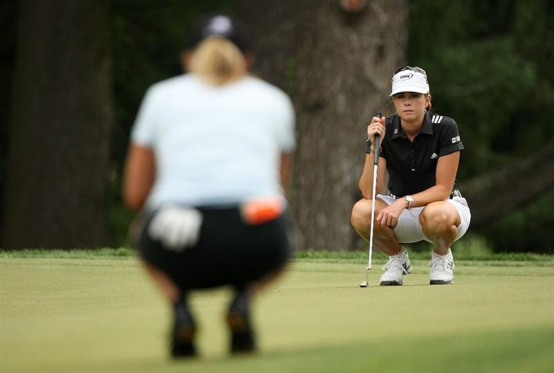 BETHLEHEM, PA - JULY 11:  Cristie Kerr (L) lines up a putt as Paula Creamer (R) looks over during the third round of the 2009 U.S. Women's Open at Saucon Valley Country Club on July 11, 2009 in Bethlehem, Pennsylvania.  (Photo by Streeter Lecka/Getty Images)