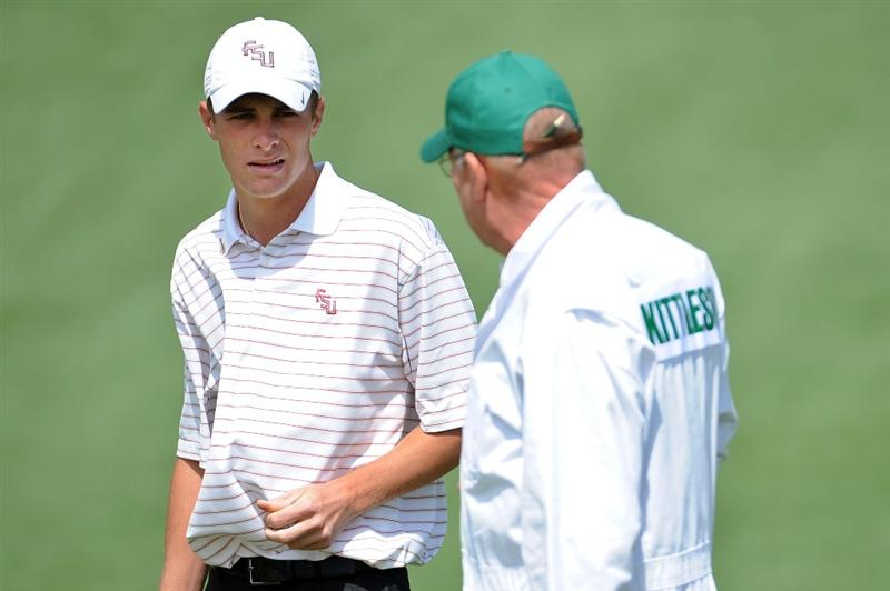 AUGUSTA, GA - APRIL 06:  Amateur Drew Kittleson waits with his caddie on a green during a practice round prior to the 2009 Masters Tournament at Augusta National Golf Club on April 6, 2009 in Augusta, Georgia.  (Photo by Harry How/Getty Images)