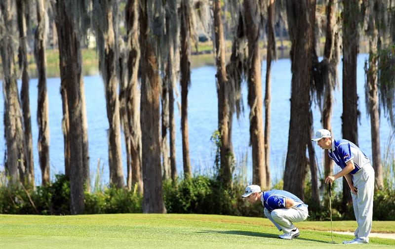 ORLANDO, FL - MARCH 14:  Oliver Wilson of England and Ross Fisher of England and the Lake Nona Club on the 17th green during the first day of the 2011 Tavistock Cup at Isleworth Golf Club on March 14, 2011 in Orlando, Florida.  (Photo by David Cannon/Getty Images)