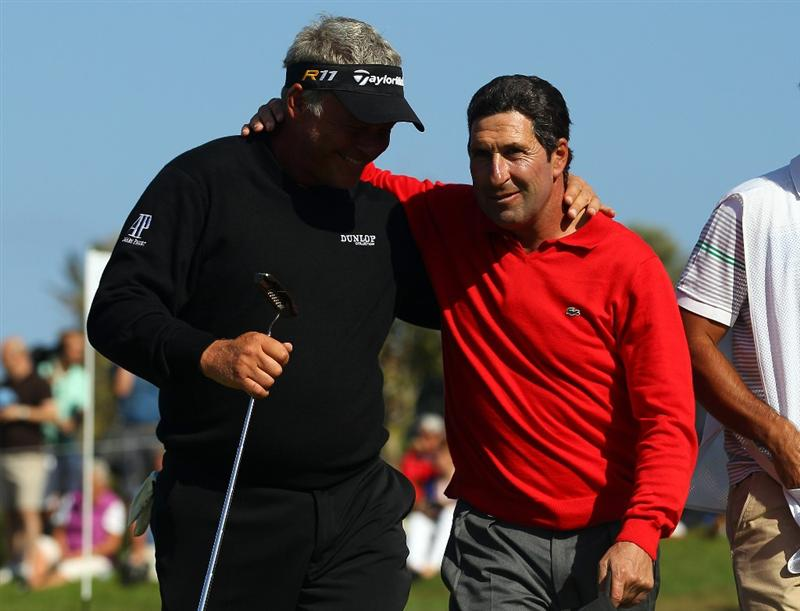 MALLORCA, SPAIN - MAY 15:  Darren Clarke of Northern Ireland is congratulated by Jose Maria Olazabal of Spain after his round during day four of the Iberdrola Open at Pula Golf Club on May 15, 2011 in Mallorca, Spain.  (Photo by Julian Finney/Getty Images)