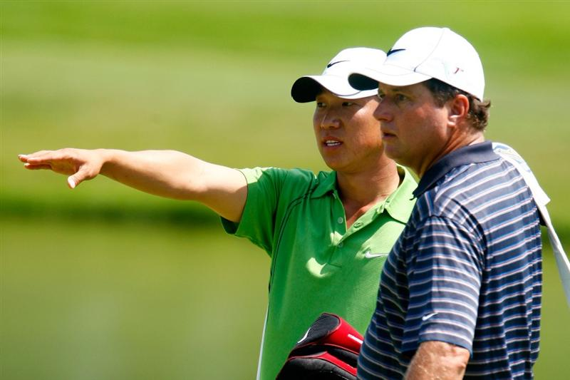 CHASKA, MN - AUGUST 12:  Anthony Kim chats with his caddie Eric Larson during the third preview day of the 91st PGA Championship at Hazeltine National Golf Club on August 12, 2009 in Chaska, Minnesota.  (Photo by Scott Halleran/Getty Images)