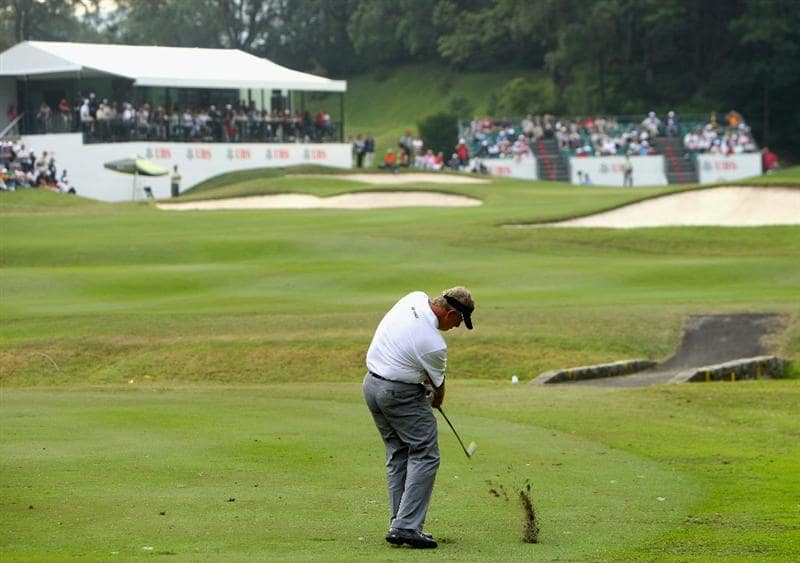 HONG KONG, CHINA - NOVEMBER 22:  Colin Montgomerie of Scotland plays his approach shot on the 17th hole during the third round of the UBS Hong Kong Open at the Hong Kong Golf Club on November 22, 2008 in Fanling, Hong Kong.  (Photo by Stuart Franklin/Getty Images)