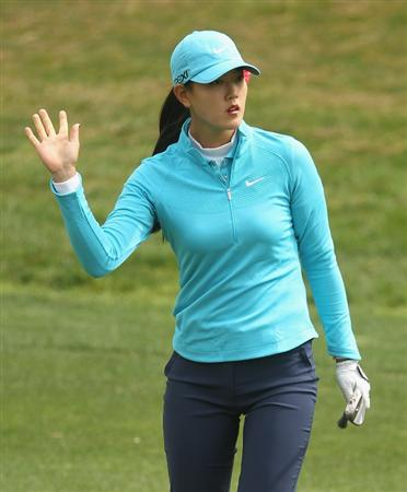 CITY OF INDUSTRY, CA - MARCH 26:  Michelle Wie waves to the gallery on the fifth hole during the third round of the Kia Classic on March 26, 2011 at the Industry Hills Golf Club in the City of Industry, California.  (Photo by Scott Halleran/Getty Images)