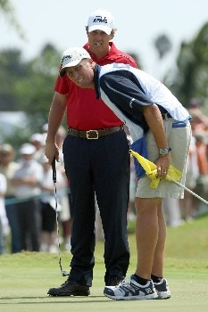 MIAMI - MARCH 21:  Phil Mickelson of the USA lines up an eagle attempt at the 1st hole with the help of his caddie Jim 'Bones' McKay during the second round of the 2008 World Golf Championships CA Championship at the Doral Golf Resort & Spa, on March 21, 2008 in Miami, Florida.  (Photo by David Cannon/Getty Images)